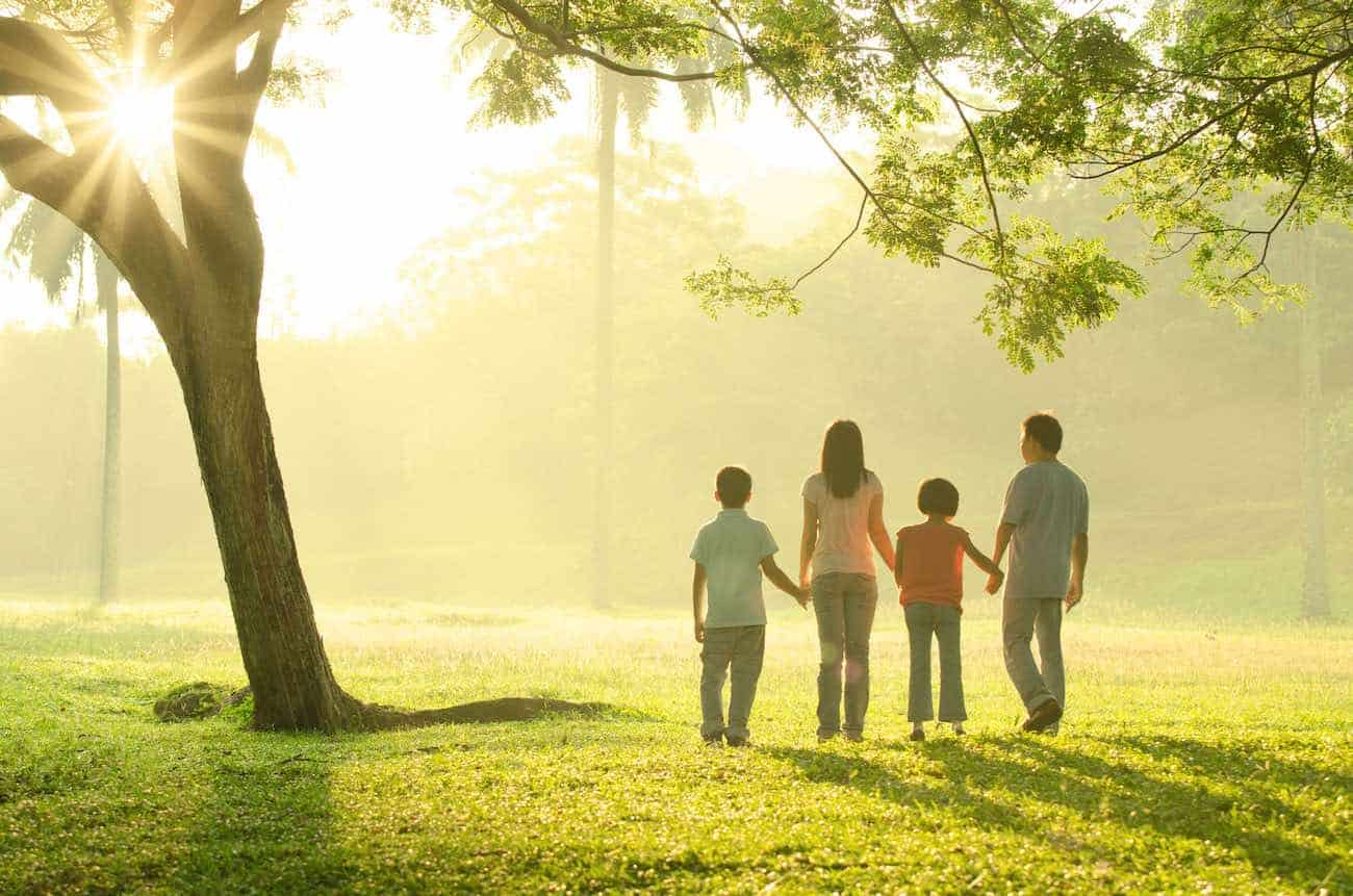 asian family walking outdoor in the morning sunlight